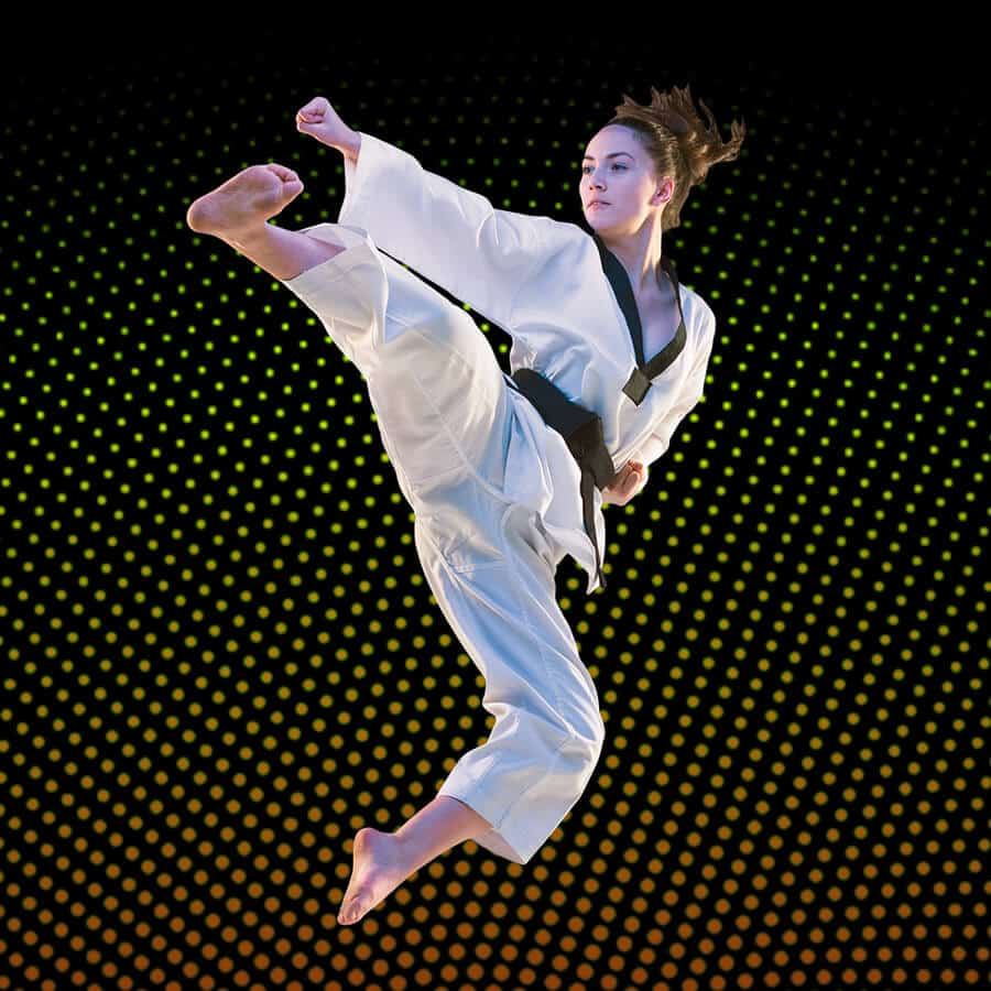 Martial Arts Lessons for Adults in Campbell CA - Girl Black Belt Jumping High Kick