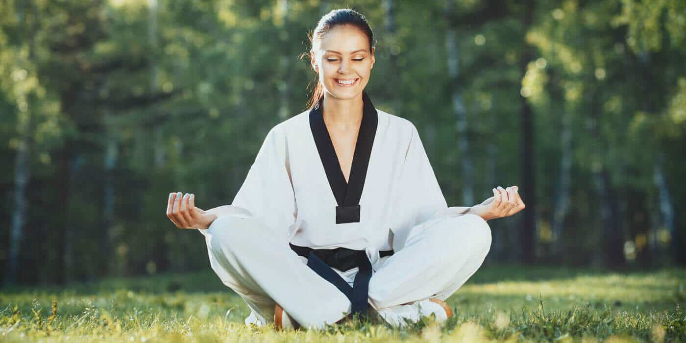 Martial Arts Lessons for Adults in Campbell CA - Happy Woman Meditated Sitting Background